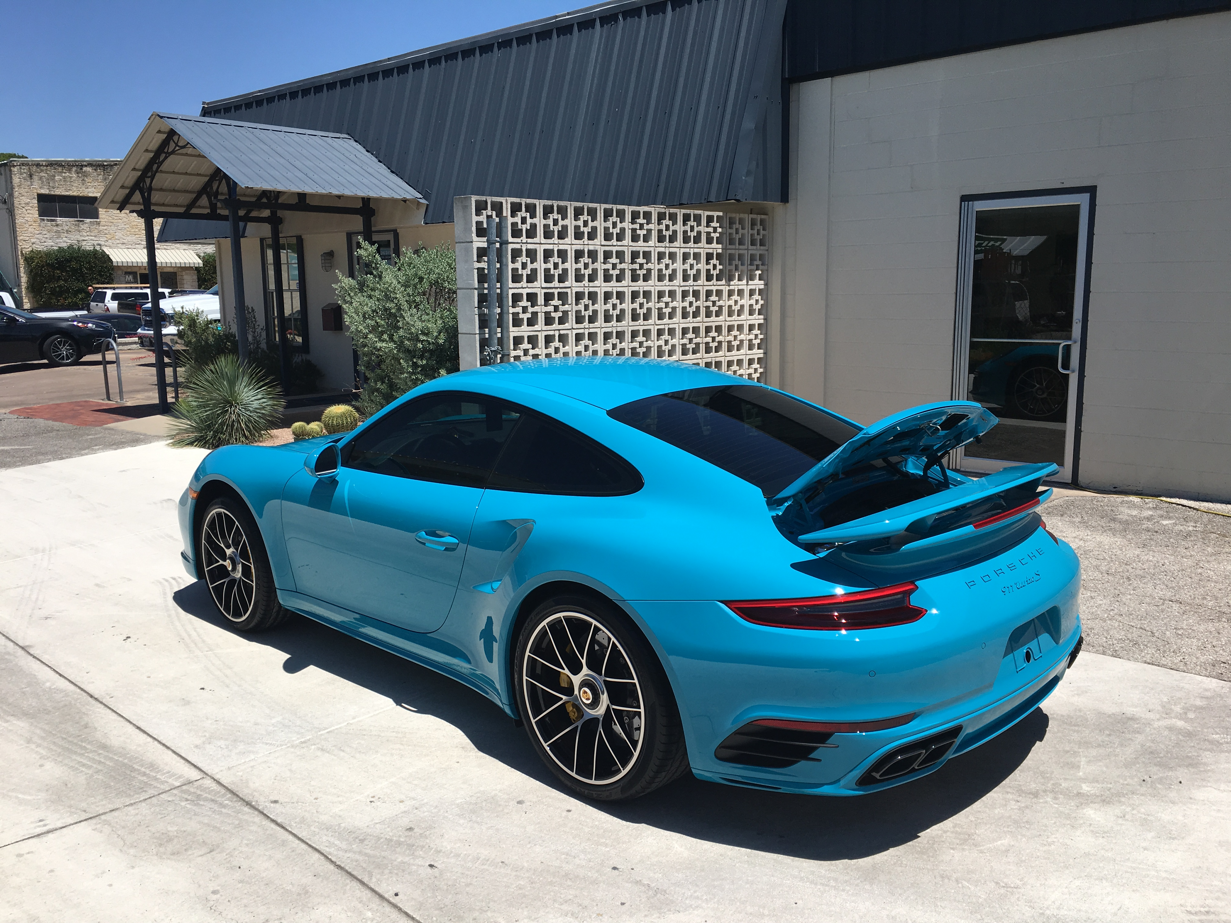 window tinting on Blue Porsche