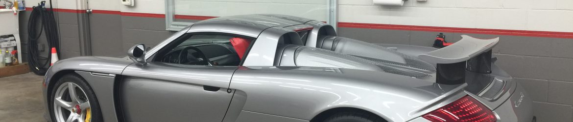 Silver porsche with pain protection