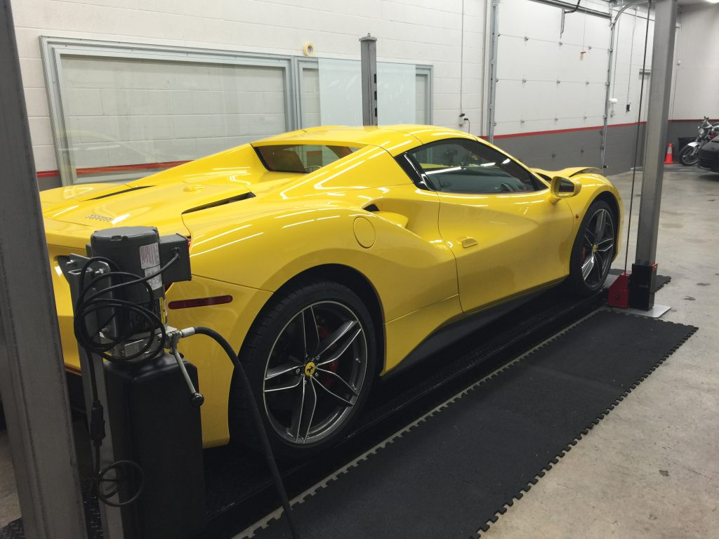 Yellow Ferrari being worked on at Sunbusters