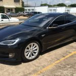 black tesla with window tint